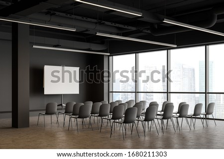Corner of modern industrial style office lecture hall with grey walls, concrete floor, rows of gray chairs and mock up projection screen. Concept of presentation and education. 3d rendering