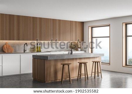 Corner of modern kitchen with white walls, concrete floor, bar counter with stools and white cupboards. 3d rendering