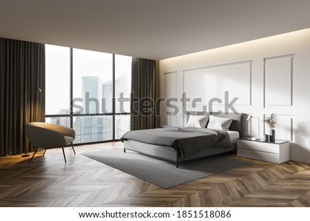 Corner of modern master bedroom with white walls, wooden floor, comfortable king size bed and armchair. 3d rendering Сток-фото ©