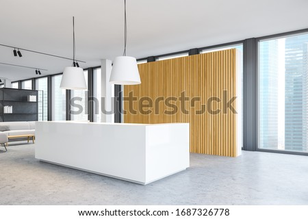 Corner of modern minimalistic office with white and wooden walls, concrete floor and comfortable reception desk standing near window with blurry cityscape. Sofa in waiting room. 3d rendering