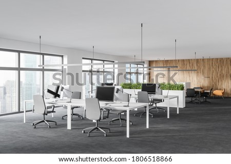Corner of modern open space office with white and wooden walls and rows of white computer tables. 3d rendering Stockfoto ©