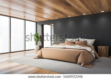 Corner of stylish panoramic bedroom with grey walls, wooden floor and ceiling, cozy king size bed with beige blanket and two round bedside tables. Blurry cityscape. 3d rendering