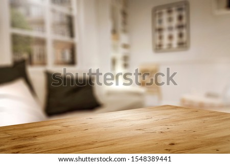 Corner of table with empty space for your product. Blurred home interior and christmas time. Copy space.  Foto d'archivio ©