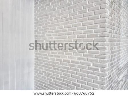 corner of white room with white brick wall  Foto d'archivio ©