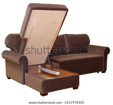 Corner sofa isolated on white background. Including clipping path. Chocolate color sofa. Opened storage for bed linen #1411970105