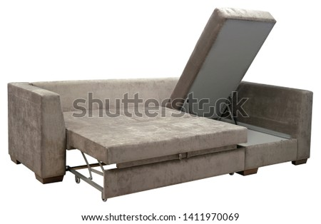 Corner sofa isolated on white background. Including clipping path. Opened storage for bed linen #1411970069