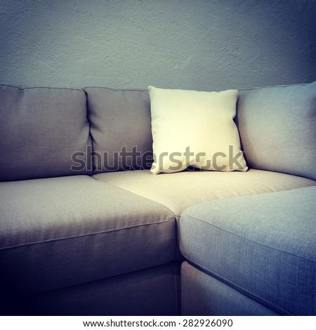 Corner sofa with white cushion. Modern furniture.