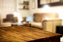 Corner table background of free space for your decoration and blurred home interior with brown sofa. Christmas time in home and warm light.