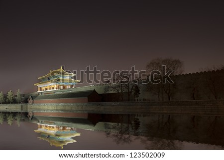 Corner turret of the Forbidden City surrounded by Moat,  at night. Beijing, China.