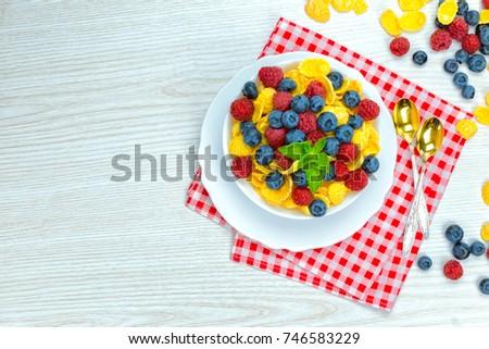cornflakes, breakfast of cornflakes and berries #746583229