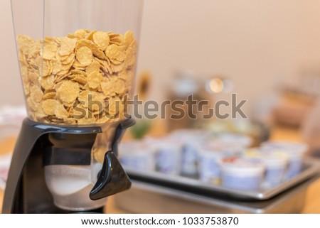 Cornflakes dispenser. Self service breakfast #1033753870