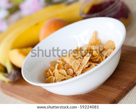 cornflakes in white bowl on table