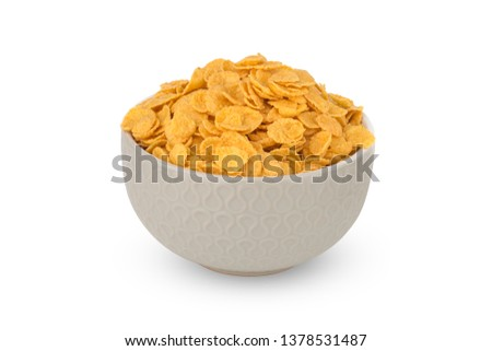 Cornflakes on a white background. Cornflakes in a bowl close-up. #1378531487