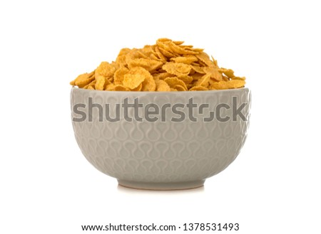 Cornflakes on a white background. Cornflakes in a bowl close-up. #1378531493