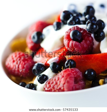 Cornflakes with fresh fruits and yogurt - stock photo