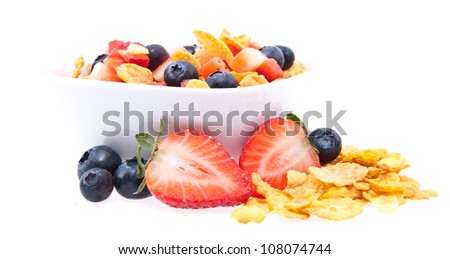 Cornflakes with fresh fruits in a bowl isolated on white background
