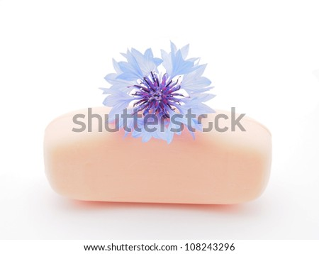 cornflowers and soap on a white background