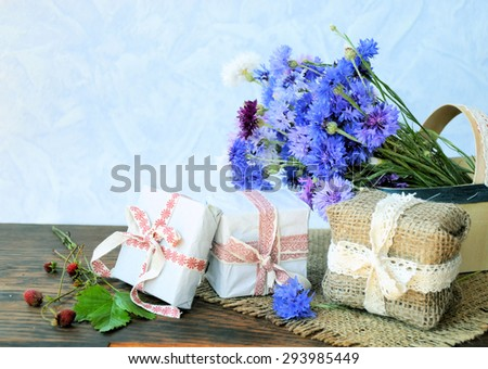 cornflowers flowers and gift, background