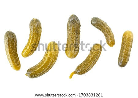 Cornichons - small pickled cucumbers isolated on a white background. Top view. Photo stock ©
