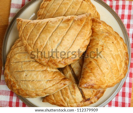 Cornish pasties piled on a plate