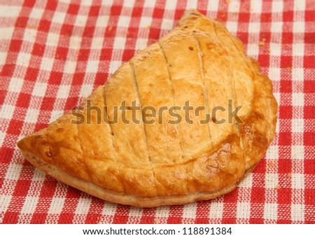 Cornish pasty on red checked napkin
