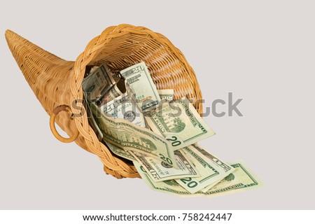 Cornucopia overflowing with U.S. twenty dollar bills with a shallow depth of field and copy space #758242447