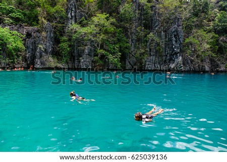 Coron, Philippines - Apr 9, 2017. Tourists enjoying on the Kayangan Lake in Coron Island, Philippines. Coron has been described as one of the best spots in the World for Wreck diving.