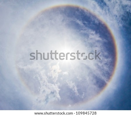 Corona on blue sky, the sun with the ring