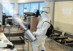 Corona spraying in office floor
