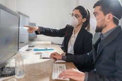 Corona Virus. Office workers with mask for corona virus. Business workers wear masks to protect and take care of their health. Office working with computer. Working from home.