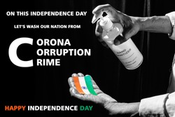 corona virus pandemic or covid-19 in India. man using hand sanitizer on flag and giving message, wash coron, corruption, crime from India in this Independence day of India