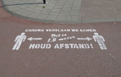 Corona virus warning in the Netherlands. Translation: We defeat corona together, this is 1.5 meters, maintain distance.