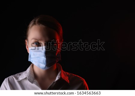 coronavirus, a girl in a mask on a black background. Title about the outbreak of the corona virus in China, illness. Epidemic