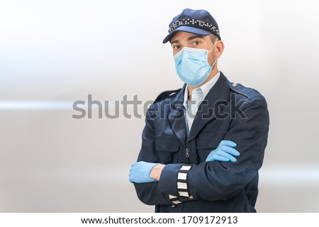 Coronavirus concept. Police officers are heroes. Policeman with face protection mask. End of the epidemic. We are safe. Coronavirus ended. We won. No more quarantine. Breathe deep. Take off the mask.