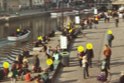 Coronavirus contact tracing, exposure detection app concept. Infected people in the crowd marked with yellow circles. Covid-19 spread prevention technology. Motion blur