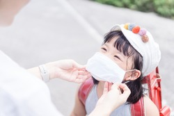 Coronavirus Covid-19 and Air pollution concept.Asian girl and mother wearing mask.Back to school.New normal post covid-19.Reopen school and infected like kawasaki disease.Education back to School kid.