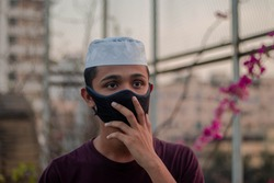 Coronavirus Covid-19 concept.Man wearing face mask protect from virus and show hand gesture.Coronavirus outbreak in saudi arabia. coronavirus and pandemic virus symptoms.Muslim during ramadan kareem
