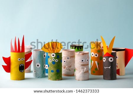 Coronavirus COVID-19 disease 2020 paper toy ghost, bat, monsters for Halloween party. Easy crafts for kids on blue background, copy space, die creative idea from toilet tube, recycle concept