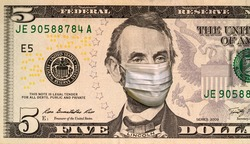 Coronavirus COVID-19 in USA. Quarantine and global recession. Abraham Lincoln in healthcare surgical mask on a five dollar bill. Global economy hit by corona virus outbreak and pandemic.