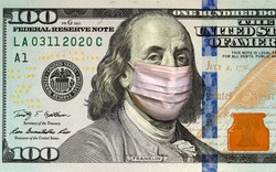 Coronavirus COVID-19 in USA. Quarantine and global recession. Benjamin Franklin in healthcare surgical mask on a one hundred dollar bill. Global economy hit by corona virus outbreak and pandemic.