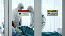 coronavirus covid 19 infected patient in quarantine room with quarantine and outbreak alert sign at hospital with coronavirus covid 19 disease control experts make coronavirus disease treatment