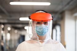 Coronavirus COVID-19 virus disease global pandemic outbreak,UK NHS frontline medical key worker,EMS Personal Protective Equipment,parking lot hallway,emergency ICU Intensive Care Unit first responder