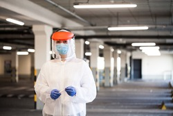Coronavirus COVID-19 virus disease pandemic outbreak,UK NHS EMS key medical worker in Personal Protective Equipment,US hospital parking drive-thru rt-PCR test lot,Intensive Care Unit first responder