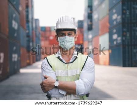 Coronavirus Disease or COVID can spread easily without mask. Quarantined masked workers protect spreading of Covid 19 by wearing face masks. Workers are engineer wear masks during quarantine time Stock fotó ©