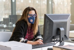 Coronavirus. Girl at the office sick with mask for corona virus. Business woman wear mask to protect and take care of their health.