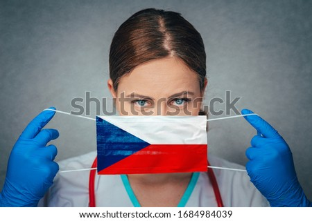 Coronavirus in Czechia, Czech Republic Female Doctor Portrait hold protect Face surgical medical mask with Czech Republic National Flag. Illness, Virus Covid-19 in Czech Republic, concept photo Foto stock ©