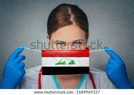 Coronavirus in Iraq Female Doctor Portrait hold protect Face surgical medical mask with Iraq National Flag. Illness, Virus Covid-19 in Iraq, concept photo