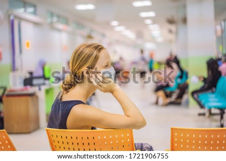 Coronavirus in the hospital covid 19. Woman in a medical mask Patients In Doctors Waiting Room
