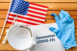 Coronavirus in United States,. Flag of United States,, vaccine, face mask for virus, glove and paper sheet with words Coronavirus COVID-19
