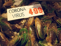 coronavirus infected mussels  at wuhan wet market in china.  The corona virus has possibly come form this market in china. The virus has spread worldwide. seafood used for cooking and cuisine.
